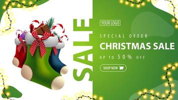 Special offer, Christmas sale, up to 50 off, green discount banner with Christmas stockings and garland