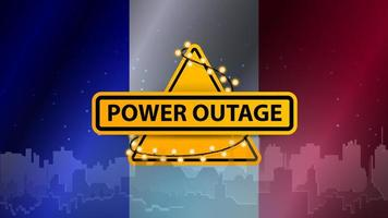Power outage, yellow warning sign wrapped with garland on the background of the flag of France with the silhouette of the city on the background vector