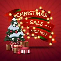 Christmas sale, shop now, discount banner in the form of ribbons wrapped garland and Christmas tree in a pot with gifts vector