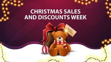 Christmas sales and discounts week, white and purple discount banner with garland, wavy line and present with Teddy bear