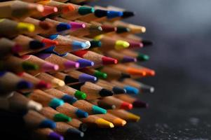Close-up group of colored pencils, selected focus on red
