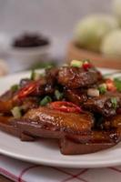 Sweet pork sprinkled with chili and chopped scallions