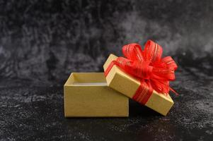 Gift box with a red bow tied and opened