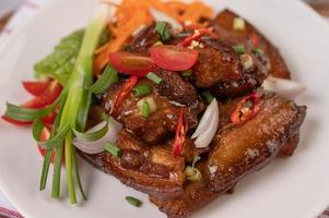 Sweet pork with chopped scallions, chili, lime, gourd, tomato and garlic