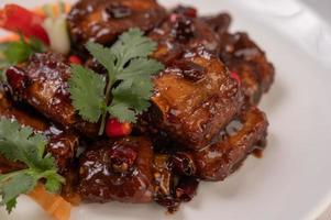 Sweet pork with chili, spring onions, carrots and coriander photo