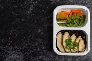 Purple rice berries with grilled chicken and pumpkin, carrots and mint leaves photo