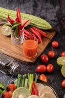 Juice and tomatoes with peppers, lime and bitter gourd