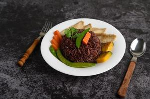 Purple rice berries with grilled chicken breast and pumpkin and carrot photo