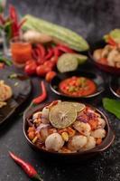 Spicy meatball salad with chili, lemon, garlic and tomato photo