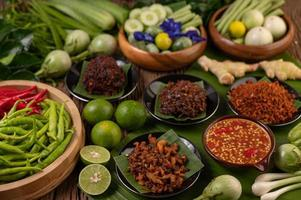 Different types of chili sauce with ingredients to make a Thai cuisine