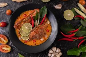 Tom yum crab with lemon, chili, tomato, garlic, lemongrass and kaffir lime