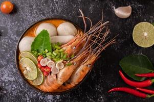Tom yum soup with shrimp and crab with lime, chili, tomato and garlic