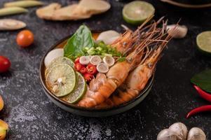 Tom Yum Kung soup with tomato, chili, lemongrass, garlic, lemon, and kaffir