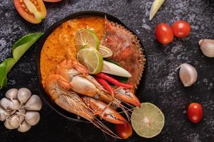Tom yum with shrimp and crab and lime, chili, tomato and garlic