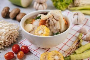 Chicken soup with corn, shiitake mushroom, enoki mushroom and carrot