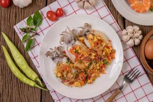 Stir fried glass noodles with squid on a red and white cloth photo
