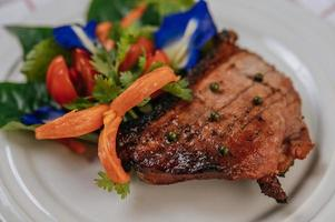Pork steak with tomato, carrot, red onion, peppermint, butterfly pea flower and lime