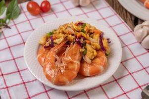 Fried shrimp with eggs on a red and white cloth photo