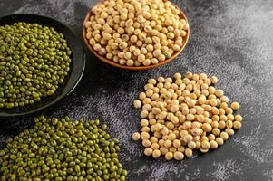 Soybean and mung bean on a black cement floor background