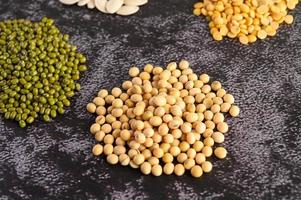Soybean and mung bean on a black cement floor background photo