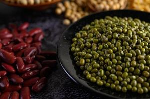 Mung bean and red bean on a black cement floor background