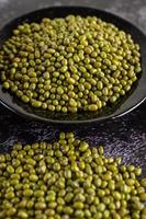 Mung beans on a plate on black cement