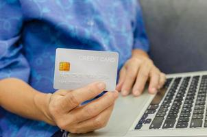 Woman holding a grey credit card
