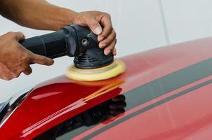 Polishing a red car photo