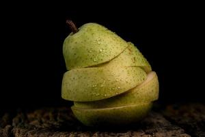 Green pear on black
