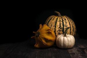Pumpkins on dark background