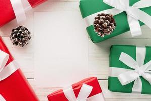 Red and green presents with decor on table