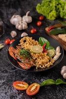 Crab with noodles and lemon, chili, tomato, garlic and lemongrass photo