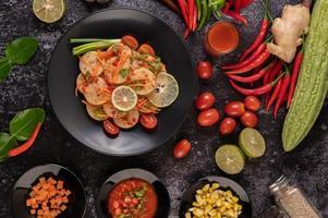 Vietnamese pork sausage salad with chilli, lemon, garlic and tomato