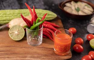 Juice and tomatoes with peppers, lime and bitter gourd photo