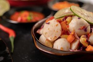 Spicy meatball salad with chili, lemon, garlic and tomato