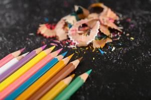 Close-up of color pencils and shavings, flat lay