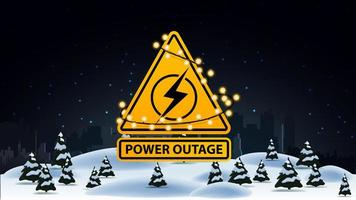Power outage, yellow warning logo wrapped with a garland on the background of the city without electricity and winter landscape