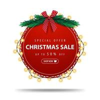 Special offer, Christmas sale, up to 50 off, round red discount banner wrapped with garland isolated on white background