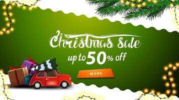 Christmas sale, up to 50 off, green and white discount banner with wavy diagonal line, orange button, Christmas tree branches and red vintage car carrying Christmas tree