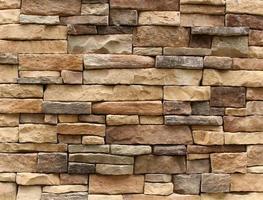 fondo de pared de piedra marrón foto