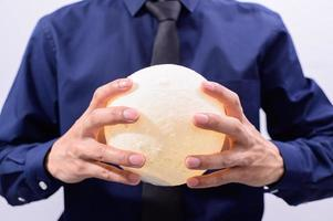 Business professional holding a moon lamp photo