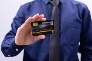 Man holding a black credit card