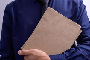 Person holding folders photo