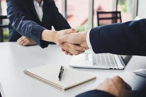 Two people shaking hands photo
