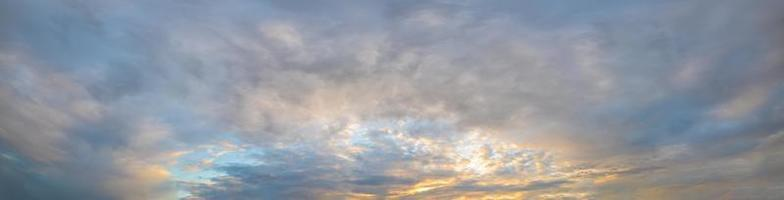 Panorama of clouds in the sky at golden hour photo