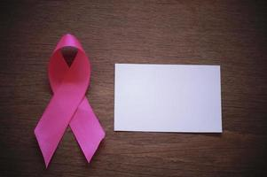 Pink ribbon with a white paper photo