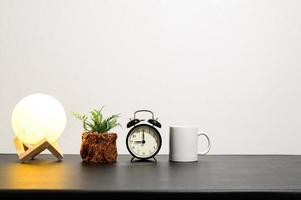 Lamp with a plant, clock and mug