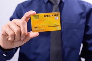 Business person holding a credit card