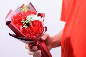 Hand holding a bouquet