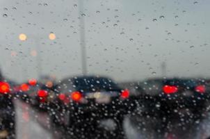 Blurred cars in the rain photo
